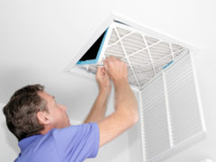 Man Removing Dirty Air Filter - Consign Living
